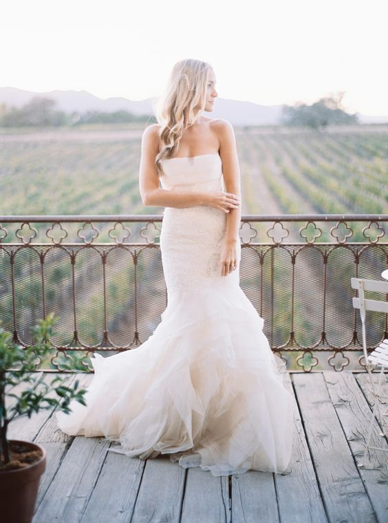 a strapless ivory mermaid wedding dress with a ruffled tail by Vera Wang