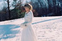 03 a white wrap sweater over the wedding dress looks very elegant and refined