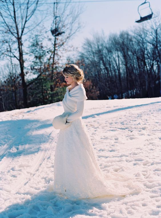 Picture of a white wrap sweater over the wedding dress for Sweater over wedding dress