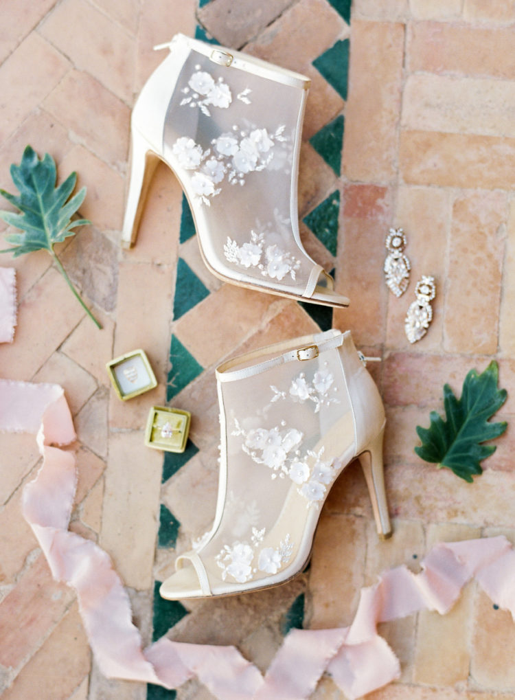 Floral lace applique booties and statement earrings finished off the bridal look