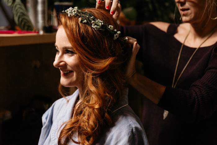 The bride was wearing a wavy side hairstyle with a subtle floral crown