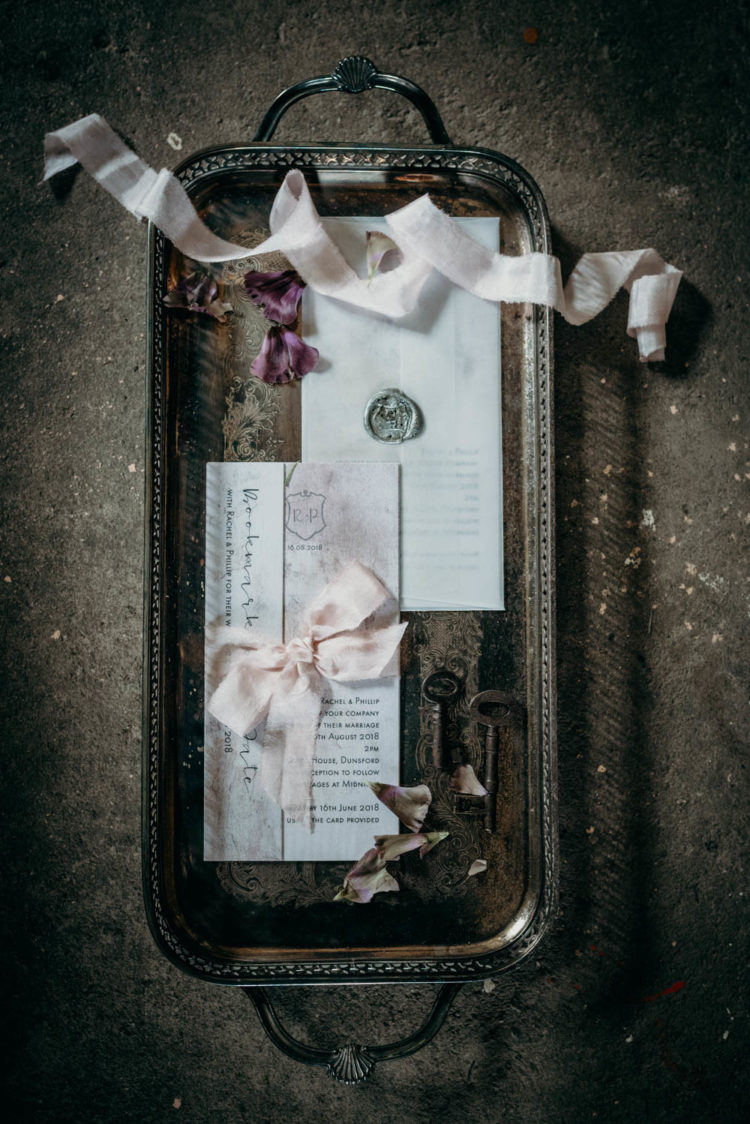 The wedding stationery was delicate, with blush ribbons and bows