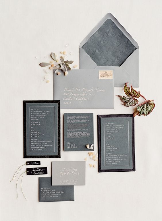 a grey wedding invitation suite with letter pressing and black touches