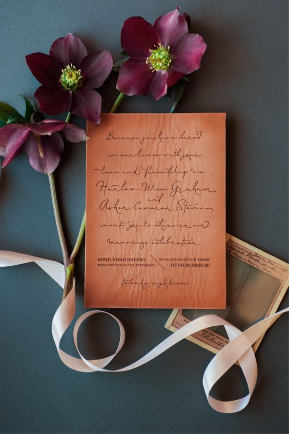 a hand writing leather invitation is a chic and unique idea to stand out