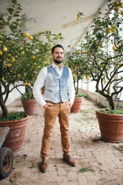 a light blue crushed velvet waistcoat for an art-inspired groom
