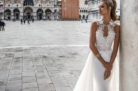 04 a sleeveless wedding dress with an embellished bodice, a sweetheart neckline and a flowy light overskirt