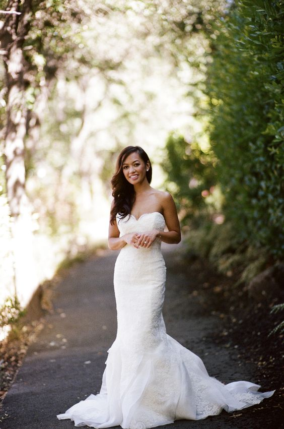 a textural lace mermaid wedding gown with a small train looks very romantic and chic
