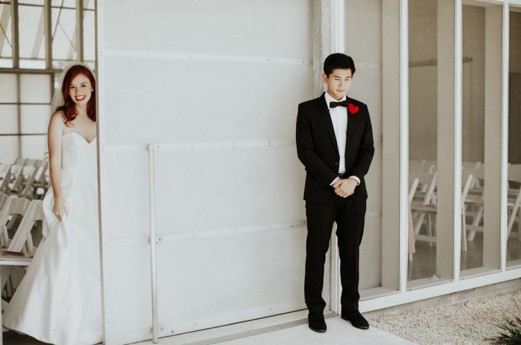 The bride chose a strapless sweetheart neckline plain wedding gown and the groom was wearing a classic black tux