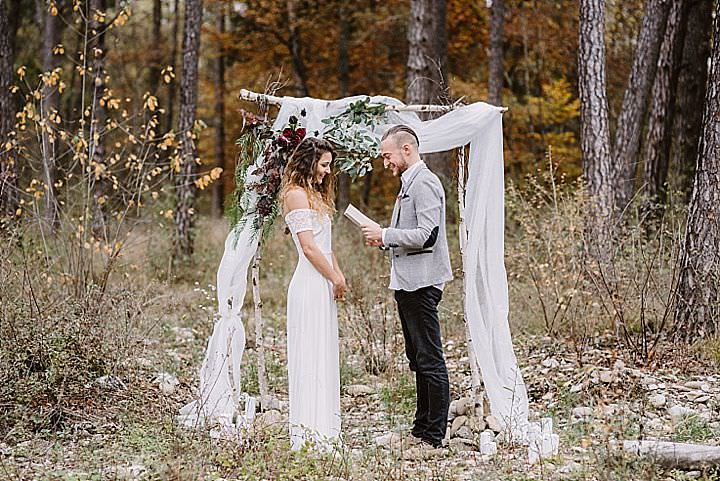 The wedding arch was made of tree branches, flowy and airy fabric and some greenery and blooms