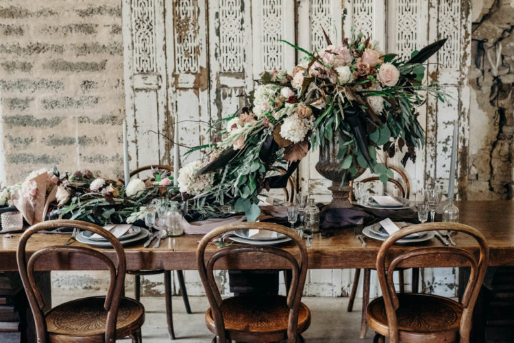 The wedding table was styled with refined fabrics like silk, a lush bloom cascading centerpiece that formed a table runner