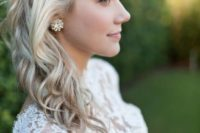 05 a braided half updo with waves for medium length hair is a chic and pretty idea