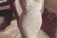 05 an off the shoulder textural embellished wedding gown with a long train