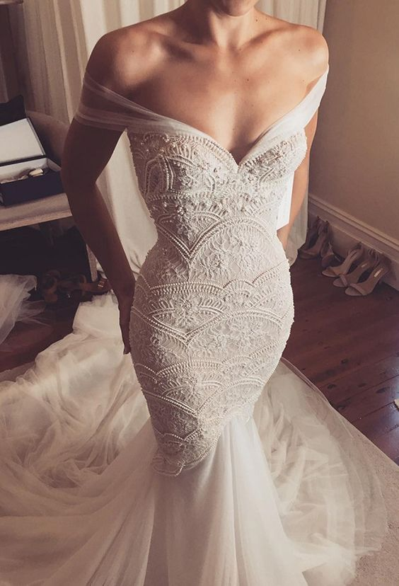 an off the shoulder textural embellished wedding gown with a long train