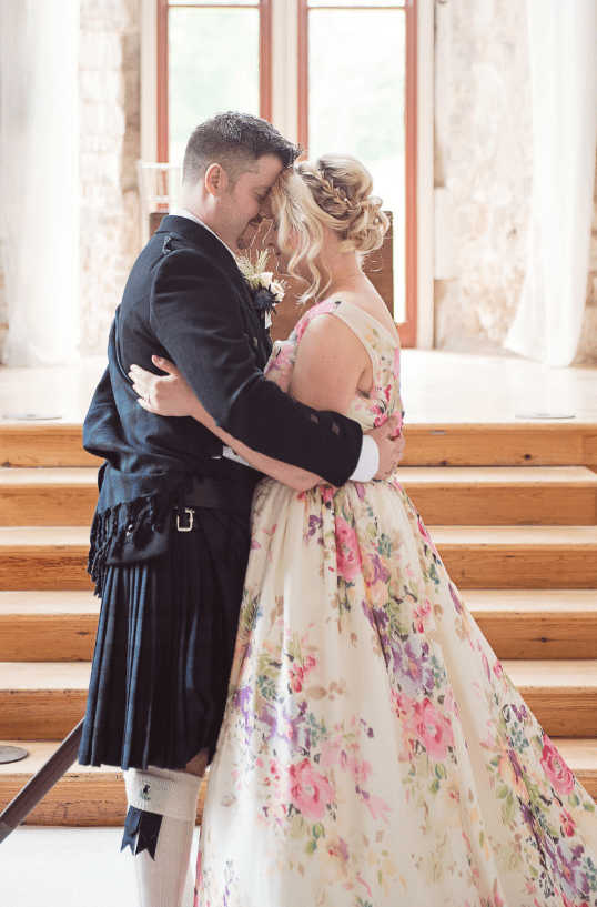 The bride took off her pirate accessories, and the groom was wearing traditional attire of his family