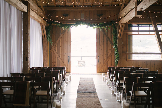 The ceremony space was decorated with greenery, candles and lights