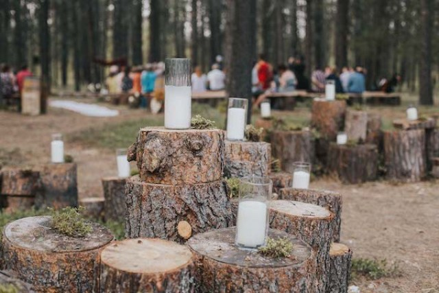 The ceremony was a woodland one, with tree stumps and candles all over