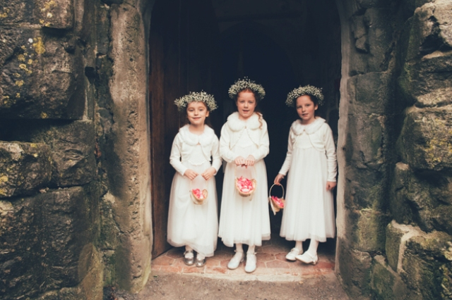 The flower girls were dressed in white and baby's breath crowns