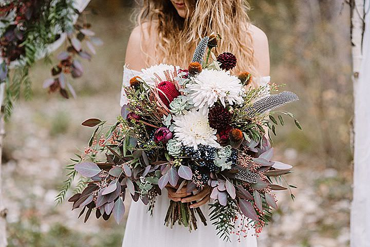 The wedding bouquet was made using greenery, blooms, various herbs and looked very boho-like