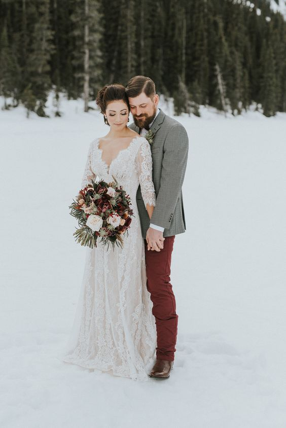 a boho lace long sleeve wedding dress with a deep V neckline looks chic and refined