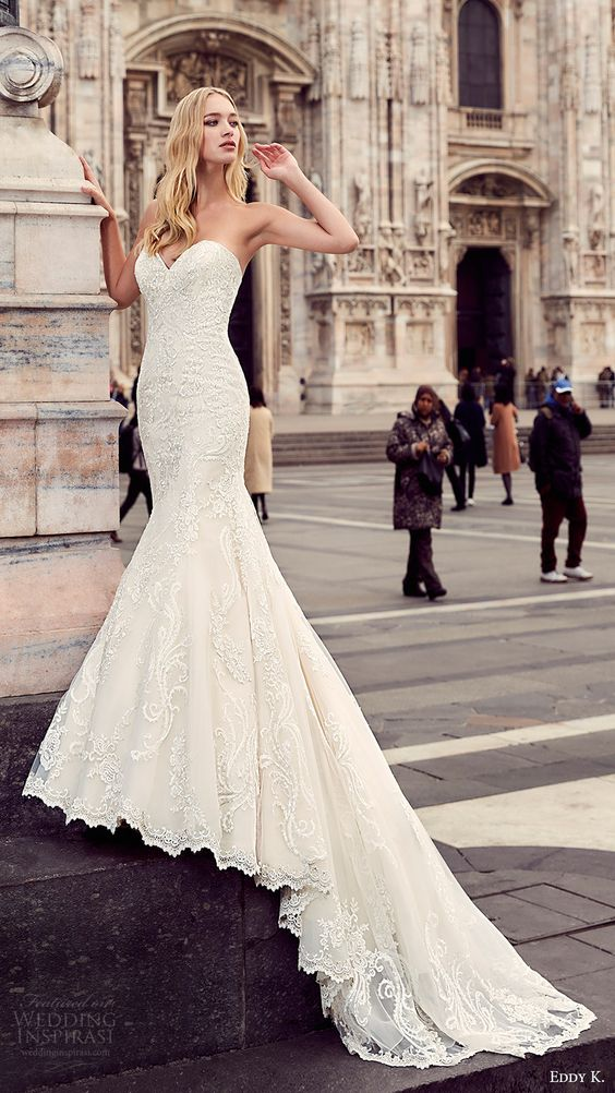 strapless textural lace applique wedding gown with a train looks chic and romantic