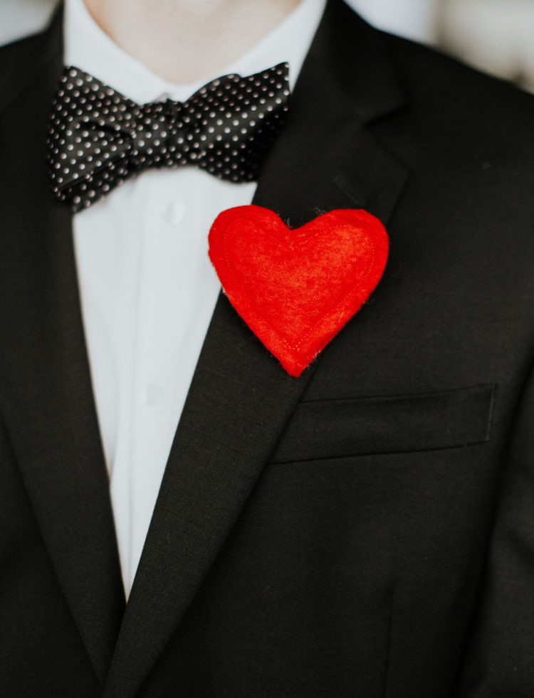 Boutonnieres were substituted with red hearts for the groom and groomsmen