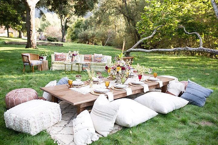 The reception was styled as a picnic with a low table and pillows