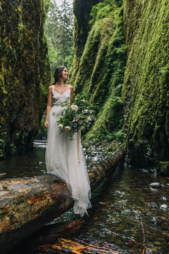 a boho lace A line wedding dress with straps, a flowy skirt is very comfy for eloping to the woods