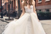 07 a lace sheath wedding dress with an overskirt, a deep V-neckline and wide straps