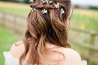 07 a messy braided half updo with waves and baby's breath for a boho, rustic or woodland bride