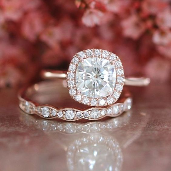 Picture Of a rose gold engagement ring with a cushion diamond and a