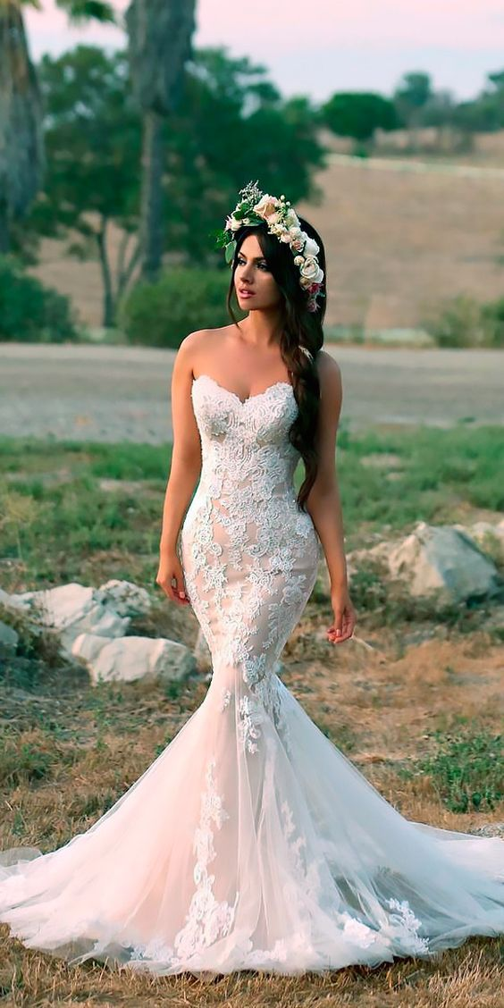 Picture Of a strapless blush mermaid wedding gown in blush with ...
