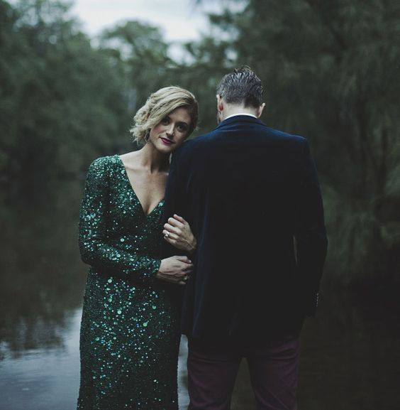 an emerald sequin wedding dress with long sleeves and a V neckline for a holiday wedding