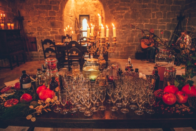 Pomegranates and lots of candles added a luxe touch to the castle decor