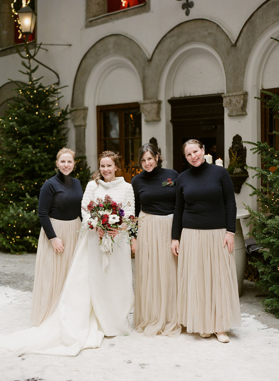 The bridesmaids were wearing blush maxi skirts and black turtleneck
