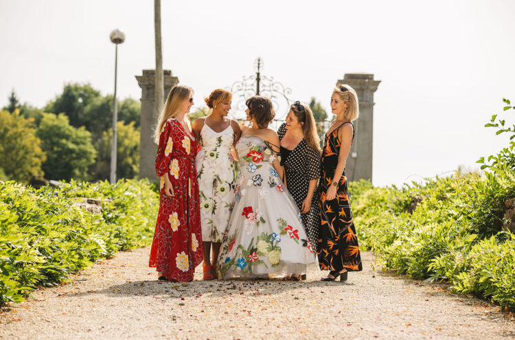 The bridesmaids were wearing various mismatching dresses of their taste