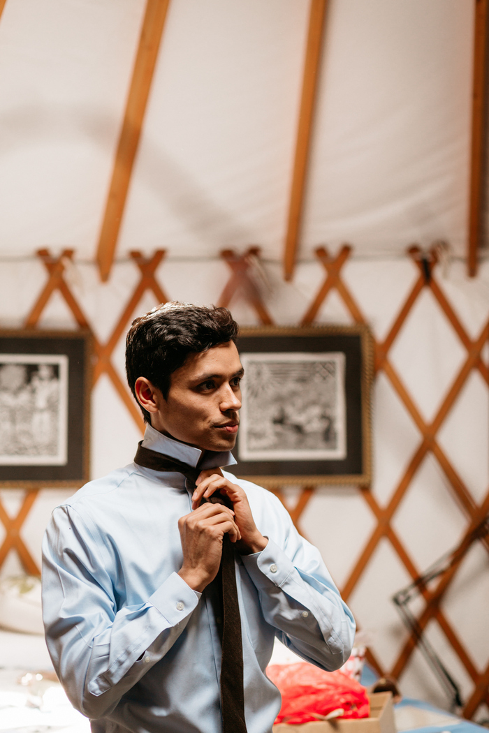 The groom was wearing a blue shirt and a brown tie