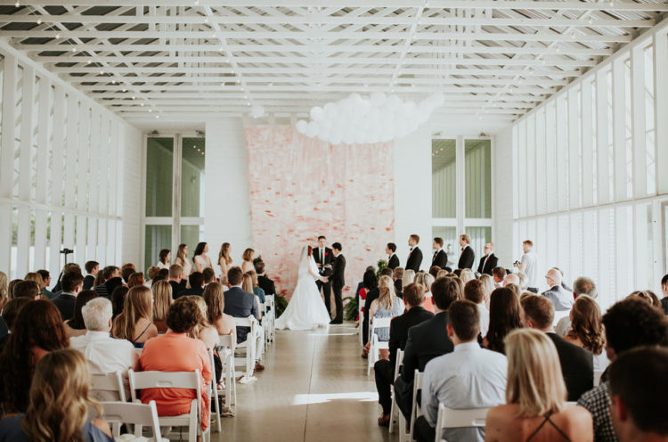 The peachy pink brushstroke backdrop was made by the couple, too
