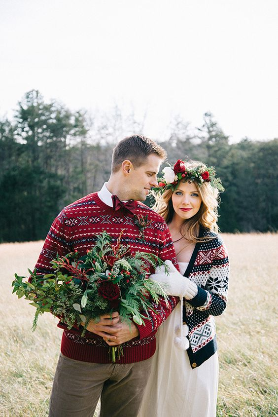 a cozy winter print red sweater and a red bow tie for a winter groom's look