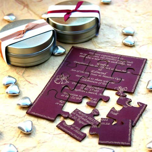 a creative wedding invitation puzzle with gold calligraphy