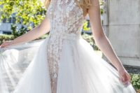 08 a high neckline floral lace applique sheath wedding dress and a layered tulle overskirt looks ethereal