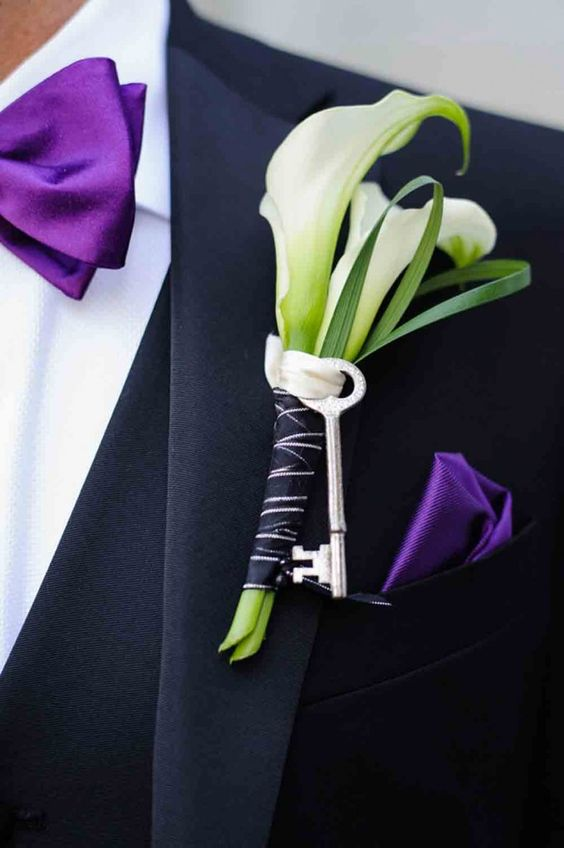 an ultra violet bow tie and a handkerchief look refined with an orchid boutonniere
