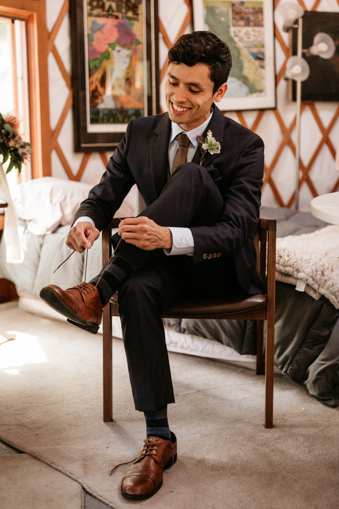 A dark brown suit was a nice idea for a relaxed forest wedding