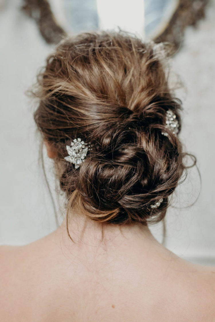 Another her hairstyle as a twisted messy updo with a couple of rinestone hairpieces