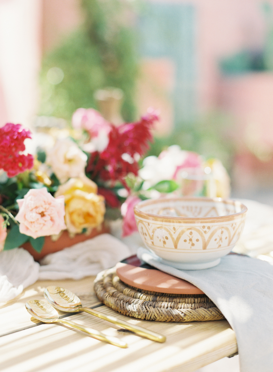 Local crockery, wicker chargers, bold blooms helped to create a chic tablescape