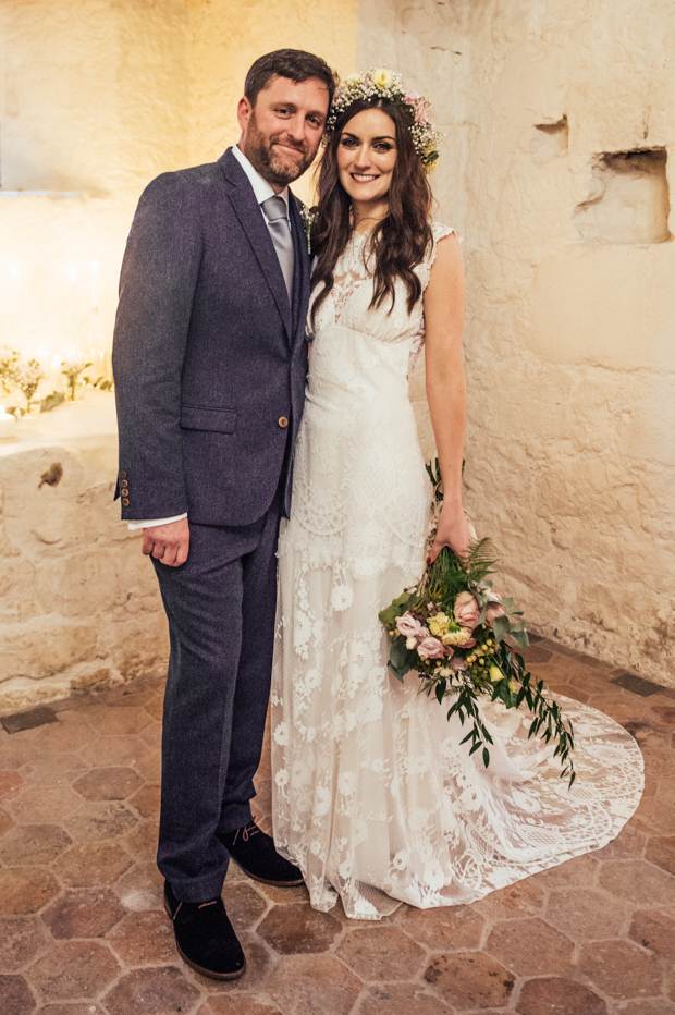 The groom was wearing a dark grey tweed suit and a dove grey tie