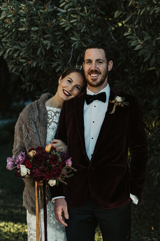 a deep burgundy velvet jacket and a black velvet bow tie for a chic look