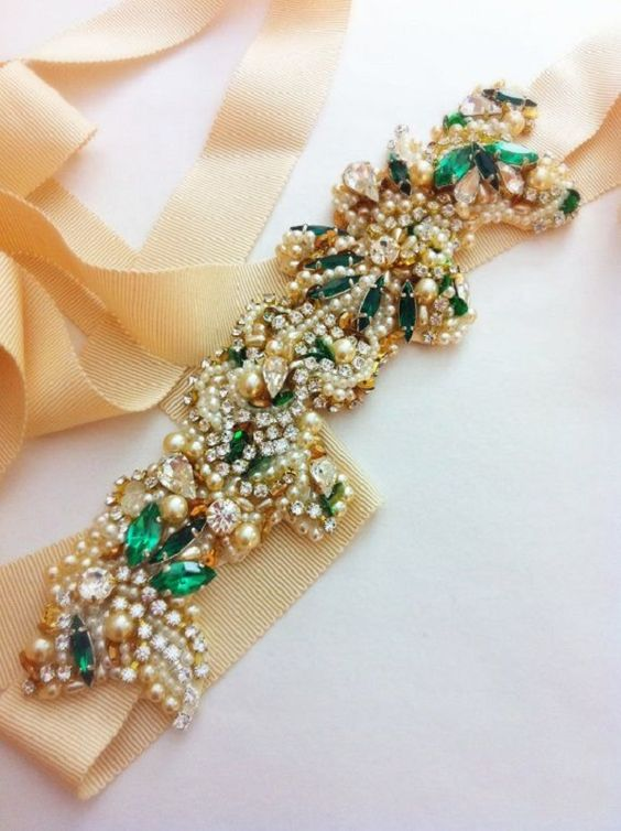 a gorgeous embellished bridal sash with pearls, rhinestones and emeralds looks wow