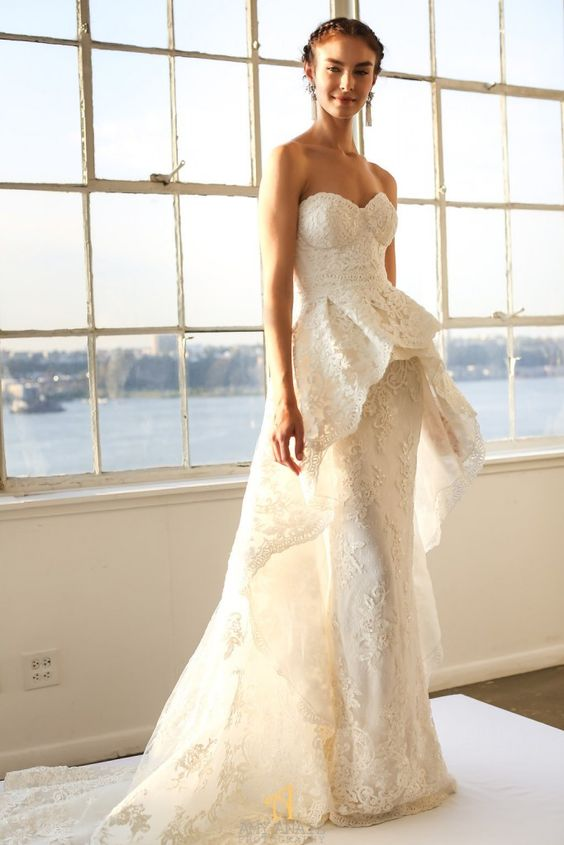 a strapless textural sheath wedding gown by Marchesa with a peplum overskirt