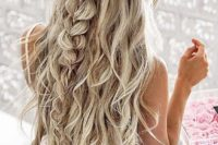 09 a twisted and braided half updo with waves for long hair looks gorgeous