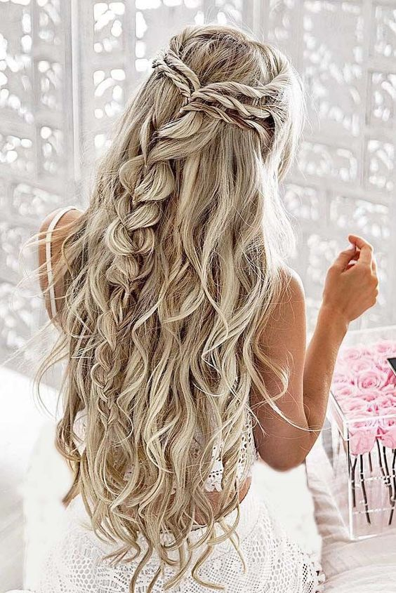a twisted and braided half updo with waves for long hair looks gorgeous